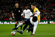 Danny Rose of Tottenham Hotspur (L) falls under a challenge from Robbie Willmott of Newport County (R). The Emirates FA Cup, 4th round replay match, Tottenham Hotspur v Newport County at Wembley Stadium in London on Wednesday 7th February 2018.<br /> pic by Steffan Bowen, Andrew Orchard sports photography.
