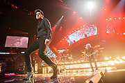 Queen with Adam Lambert performing at the iHeartRadio Music Festival at the MGM Grand Arena on Friday, September 20, 2013.