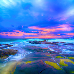 A sunrise over the rocks at Point Cartwright, Queensland Australia.