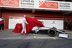 Drivers Kimi Raikkonen (left) and Antonio Giovinazzi unveil the new livery presentation of Alfa Romeo's F1 car at the Circuit de Barcelona-Catalunya.
