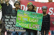 Children at 2015 May Day Rally in Portland, Oregon hold signs encouraging love and understanding
