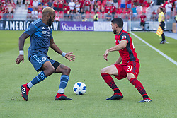 August 12, 2018 - Toronto, Ontario, Canada - MLS Game at BMO Field 2-3 New York City. IN PICTURE: JONATHAN OSORIO, SEBASTIEN IBEAGHA (Credit Image: © Angel Marchini via ZUMA Wire)