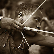 """""""The Hunter""""                                                    Tanzania<br />  He was the best shot, the best hunter, the main provider. He was about 17. I think about this often, this tribe of nomadic people, their very existence relies on the young men of their tribe. The distances they have to travel and the dangers they have to face are tasks that only the young in their tribe can do."""