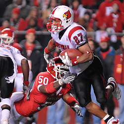 Dec. 4, 2008; Piscatway, NJ, USA; Louisville wide receiver Doug Beaumont avoids the tackle of Rutgers linebacker Antonio Lowery during a kickoff return in Rutgers' 63-14 victory at Rutgers Stadium.