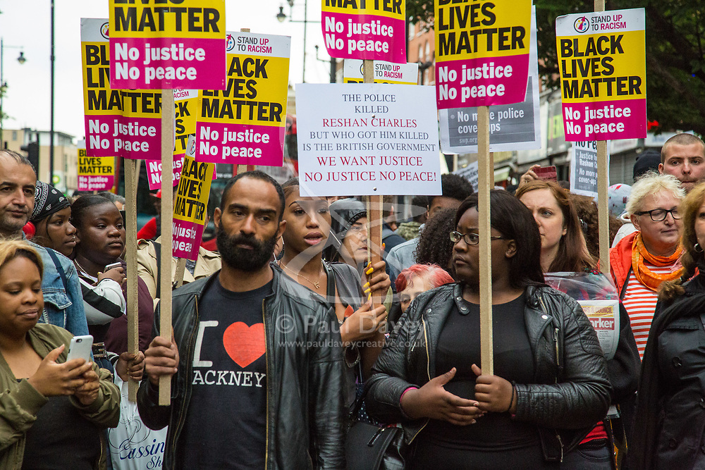 London, July 24th 2017. Protesters from Stand Up To Racism demonstrate outside Stoke Newington police station in London after Rashan Charles died after being chased and apprehended by police, who say that he tried to swallow an object after running in to a shop.