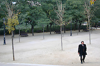 Man walking in park in Barcelona, Spain<br />