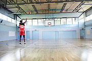 CLONDALKIN, IRELAND - August 15, 2018: Aidan puts on his old middle school jersey and gets some shots up in  his middle school gym.<br /> <br /> Photo by: Johnnie Izquierdo