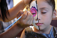 Liliana Garcia, 6, chose her own face paint colors at Sunday's annual Caminos Del Arte Day of The Dead Festival in Closter Park in Salinas.