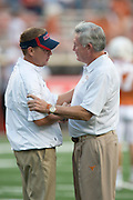 AUSTIN, TX - SEPTEMBER 14: Head coach Mack Brown of the Texas Longhorns (right) shakes hands with head coach Hugh Freeze of the Mississippi Rebels before kickoff on September 14, 2013 at Darrell K Royal-Texas Memorial Stadium in Austin, Texas.  (Photo by Cooper Neill/Getty Images) *** Local Caption *** Mack Brown; Hugh Freeze