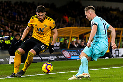 Matt Doherty of Wolverhampton Wanderers takes on Matt Ritchie of Newcastle United - Mandatory by-line: Robbie Stephenson/JMP - 11/02/2019 - FOOTBALL - Molineux - Wolverhampton, England - Wolverhampton Wanderers v Newcastle United - Premier League