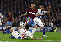 West Ham United's Marko Arnautovic (left) has a shot on goal during the Premier League match at the AMEX Stadium, Brighton.