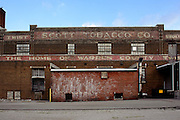 Red Brick building with company name painted on the building <br /> Scott Tobacco Warehouse