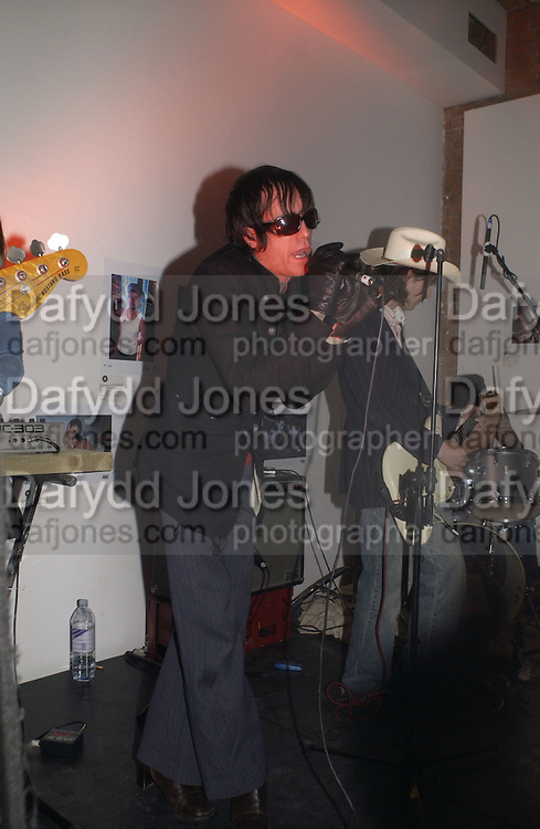 John Paul Prior singing with the Lancaster Bombers. Babyshambles Exhibition , Photographs by Danny Clifford <br />