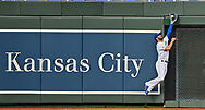 Kansas City Royals center fielder Bubba Starling (11) makes a play on a fly ball against the wall, hit by Chicago White Sox batter Eloy Jimenez (not pictured) during the first inning against the at Kauffman Stadium.