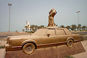 """Kuwait City, Kuwait. Monument to Sheikh Fahad Al-Sabah on Arabian Gulf Steet. The plaque below says that Sheikh Fahad Al-Sabah """"was assassinated by the Iraqi invading troops in this car on Thursday the 2nd of August, 1990, while defending his country and principles."""" (Supporting image from the project Hungry Planet: What the World Eats.)"""