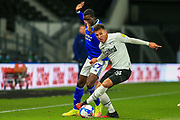 Lee Buchanan of Derby County (26)  is challenged by Cardiff City forward Sheyi Ojo (27) during the EFL Sky Bet Championship match between Derby County and Cardiff City at the Pride Park, Derby, England on 28 October 2020.