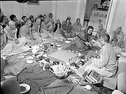 Hare Krishna Initiation, Dublin.02.05.1982..05.02.1982.2nd May 1982.1982.At the Hare Krishna Temple,Castlefield House,Knocklyon Rd,Templeogue,Dublin,new members are initiated into the Hare Krishna movement. The initiation was conducted by Guru His Divine Grace, Srila Satswarupa Das Goswami..A new member accepts the traditional offering of beads before her initiation.