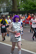 A male runner in fancy dress on Birdcage Walk during The Virgin London Marathon on 28th April 2019 in London in the United Kingdom. Now in it's 39th year, the London Marathon is a large sporting event with over 40,000 runners expected to take part.