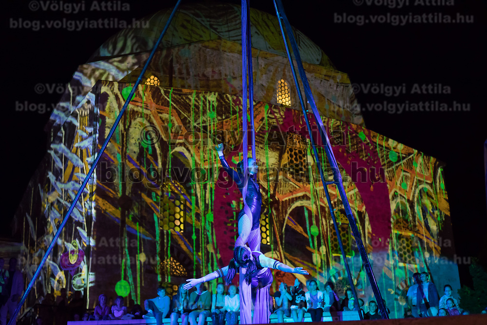 Artists perform in front of the artistic light illuminated mosque during the Zsolnay Light Festival held in central Pecs, Hungary on June 30, 2018. ATTILA VOLGYI