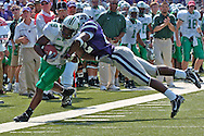 Kansas State defensive back Justin McKinney (R) pushes Marshall running back Chubb Small (L) after picking up a first down, at Bill Snyder Family Stadium in Manhattan, Kansas, September 16, 2006.  The Wildcats beat the Thundering Herd 23-7.