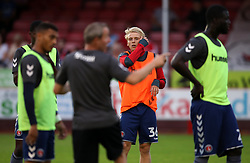 Charlton Athletic's George Lapsie (centre right) warms up prior to kick off