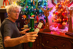 Geoff Stonebanks, 66, decorates his home in Seaford, East Sussex, with over 3,800 decorations on more than a dozen trees, creating a magical effect that truly celebrates the festive season. Seaford, East Sussex, December 03 2018.