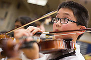 Daniel Lo of Sinnott Elementary School, 4th grade, plays the violin during the Milpitas Unified School District's Tenth Annual Music Festival at Milpitas High School in Milpitas, California, on April 4, 2013. (Stan Olszewski/SOSKIphoto)