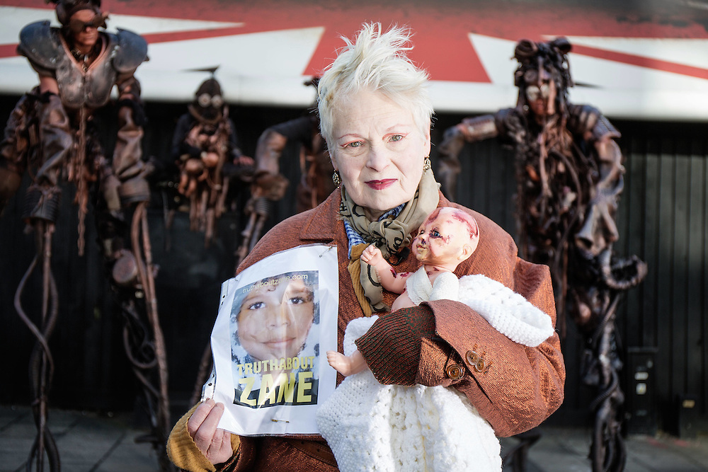 Fashion Designer Dame Vivienne Westwood poses with a projected baby injured by the effects of Fracking at a billboard to raise awareness by Westminster Bridge in London on April 27. 2015.<br /> Photos Ki Price