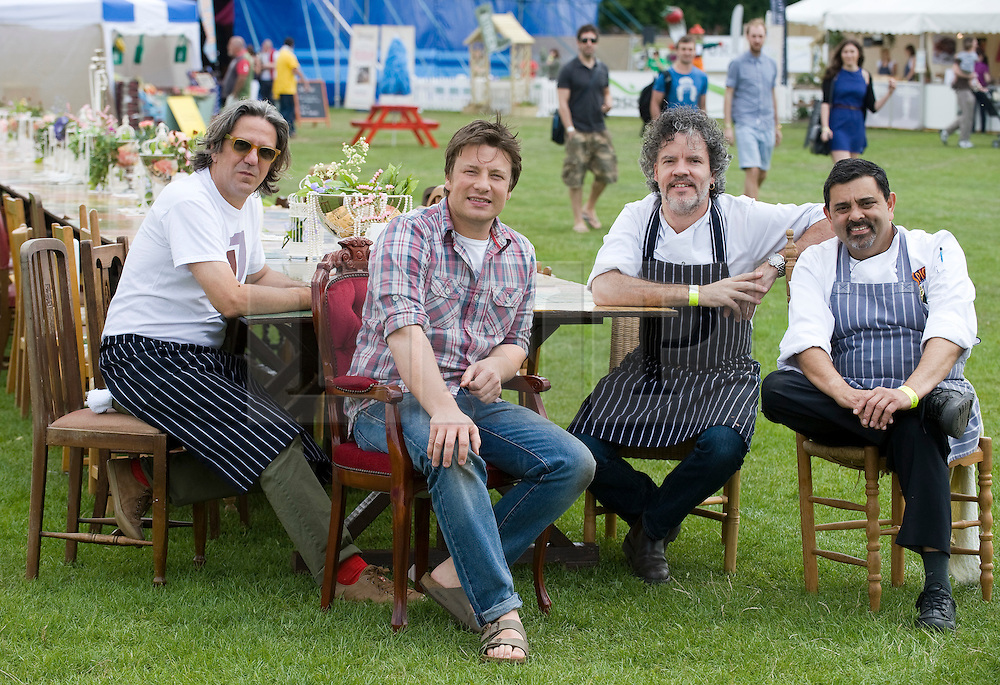 © licensed to London News Pictures. LONDON. UK.  01/07/11. HEAD OF THE TABLE... L to R Chef Giorgio Locatelli, Jamie Oliver, Chef Peter Gordon and Chef Cyrus Todiwala at the opening of Jamie Olivers 'The Big Feastival' today (01/07/2011), a three day event featuring food from some of the country's top chefs along with live music. The Big Feastival takes place on Clapham Common on the 1st, 2nd and 3rd July. All profits from the event will be shared between The Jamie Oliver Foundation and The Prince's Trust.  Photo Credit Ben Cawthra/LNP