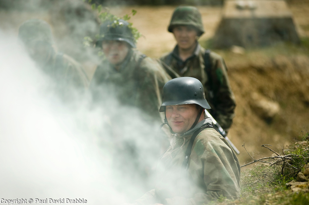 Carrying Mauser K98's and wearing splinter patteen camouflage with the the iconic coal scuttle helmet or stahlhelm, Reenactors from Northern World War Two Association take part in a 24 hour private exercise, held at Sutton Grange, near Ripon in Yorkshire 15 May 2010 .Images © Paul David Drabble.