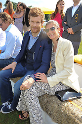TOM AIKENS and Justine Dobbs-Higginson at the 2012 Veuve Clicquot Gold Cup Final at Cowdray Park, Midhurst, West Sussex on 15th July 2012.