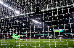 Manchester City's Raheem Sterling scores the winning penalty in the penalty shoot out during the Carabao Cup Final at Wembley Stadium, London.