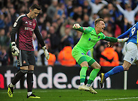 Football - 2019 EFL Checkatrade Trophy Final - Sunderland vs. Portsmouth<br /> <br /> Portsmouth goalkeeper, Craig MacGillivray celebrates after the winning goal in the penalty shoot out with a dejected Sunderland goalkeeper, Jon McLaughlin (left), at Wembley.<br /> <br /> COLORSPORT/ANDREW COWIE