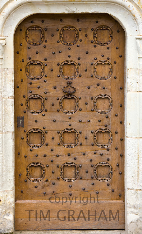Oak door at Chateau du Rivau, 15th and 16th Century Renaissance architecture, near Chinon in the Loire Valley, France