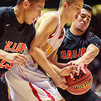 031415  Adron Gardner/Independent<br /> <br /> Gallup Bengals Sean Eskeets (23), left, and Richard Ragel (22) converge on a Centennial Hawk during a 5A New Mexico state basketball tournament final at The Pit in Albuquerque Saturday.