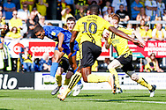 Wimbledon defender Tennai Watson (2), on loan from Reading, crosses the ball in during the EFL Sky Bet League 1 match between Burton Albion and AFC Wimbledon at the Pirelli Stadium, Burton upon Trent, England on 1 September 2018.