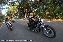 Sarah Furey, Kissa Von Addams and the Iron Lillies riding through Tamoka State Park  for the Hot Leathers ride during the Daytona Bike Week 75th Anniversary event. FL, USA. Tuesday March 8, 2016.  Photography ©2016 Michael Lichter.