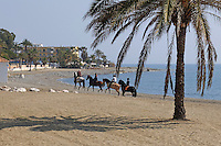Riders on the beach at San Pedro de Alcantara, Marbella, Malaga, Province, Spain, March 2015, 201503140563<br />