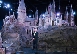 Production designer Stuart Craig  with a model of Hogwarts Castle  which was revealed for the first time , Thursday, March 1st , as part of the Warner Bros Studio tour - The Making of Harry Potter in Leavesden, Hertfordshire.  Photo by: Andrew Parsons  / i-Images