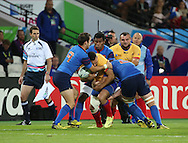Valentin Poparlan (Romania) trying to run through three French players during the Rugby World Cup Pool D match between France and Romania at the Queen Elizabeth II Olympic Park, London, United Kingdom on 23 September 2015. Photo by Matthew Redman.