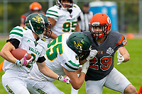 KELOWNA, BC - SEPTEMBER 22:  David Neumeier #55 of Valley Huskers tries to block Brenden Ripco #29 of Okanagan Sun as he runs in for the tackle at the Apple Bowl on September 22, 2019 in Kelowna, Canada. (Photo by Marissa Baecker/Shoot the Breeze)