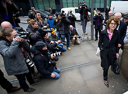 © London News Pictures. 06/03/2013 . London, UK.  Vicky Pryce (right) arriving at Southwark Crown Court in front of the media on March 6, 2013 where a jury is currently considering a verdict in her  trial for perverting the course of justice. Vicky Pryce admitted accepting penalty points incurred by her former husband and disgraced MP Chris Huhne in 2003. Photo credit : Ben Cawthra/LNP