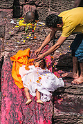 A Hindu Child's funeral at Pashupatinath Temple, a Hindu temple located on the banks of the Bagmati River. Kathmandu, Nepal. Children are considered pure and are not cremated