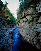Ausable River flowing through narrow gorge between walls of Potsdam Sandstone, Ausable Chasm, within blue line boundary of Adorondack Park, New York.
