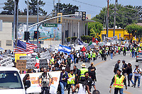 """Hundreds of marchers from the community filled east Salinas on Sunday with cries for """"Respect, Dignity, and Justice."""" The well-organized, peaceful protest started in Closter Park, and paused for prayer at two sites where residents have been killed recently in recent officer-involved shootings."""