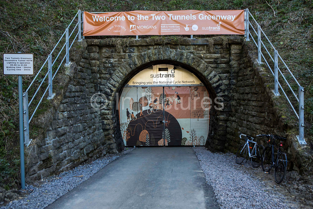 The entrance to the restored Devonshire Tunnel as part of the Two Tunnels Greenway in Bath, Somerset, England, United Kingdom. The restoration of the tunnels and 13-mile path has been organised by Sustrans, working in partnership with Bath and North East Somerset Council.   Sustrans is a charity that works with communities, policy-makers and partner organisations so that people can choose healthier, cleaner and cheaper journeys and enjoy better, safer spaces to live in.  The project was funded with lottery money. The tunnels were part of the United Kingdom's most famous railway lines which burrow beneath Combe Down.  The tunnel is 407 M long and is stone-lined throughout.  The route was opened on 6th April 2013.