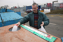 Man using the plastic bottles bank at the Tipsmart recycling centre at Calverton,