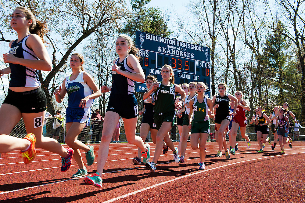 Varsity girls compete in the 1500m race during the Burlington track and field invitational at Burlington high school on Saturday afternoon May 2, 2015 in Burlington, Vermont. (BRIAN JENKINS, for the Free Press)