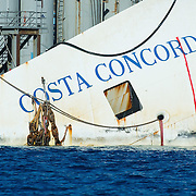 ISOLA DEL GIGLIO, ITALY - SEPTEMBER 14:  Details of the bow of the wreckage of the Costa Concordia on September 13, 2013 in Isola del Giglio, Italy. The Costa Concordia is reportedly due to be righted beginning on the morning of September 16, then, if the operation is successful, it will be towed away and scrapped.  (Photo by Marco Secchi/Getty Images)