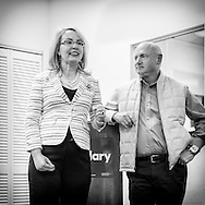 Garden City, New York, USA. April 17, 2016. GABBY GIFFORDS, former United States Congresswoman, and her husband MARK KELLY, former NASA astronaut, look at each other as they speak about the importance of GOTV, Getting Out The Vote for Hillary Clinton - including because of Clinton's strong position on stricter gun control legislation - at the Canvass Kickoff at the Nassau County Democratic Office in Garden City. After Kelly then Giffords spoke, they posed for photos with volunteers who attended the campaign Official Event. Giffords survived an assassination attempt near Tuscon, Arizona, during her first 'Congress on Your Corner' event in January 2011. Kelly commanded the final flight of the Space Shuttle Endeavor in May 2011